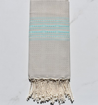 Fouta thalasso grège avec motifs mers du sud